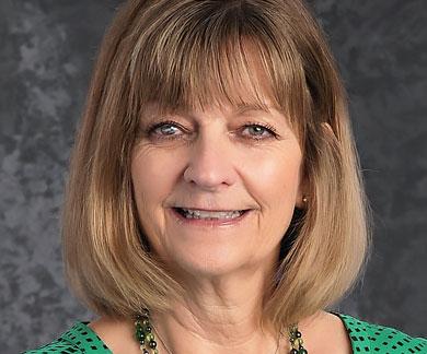 Portrait of Neighborhood Christian School secretary Mrs. Janet McNeill