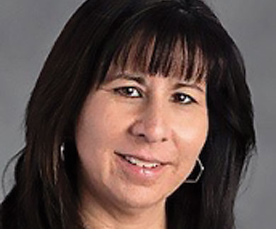 Portrait of Neighborhood Christian School teacher Mrs. Luchi Millard